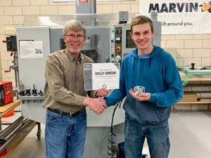 Instructor shaking hands with student completing Machatronics Academy at Bemidji High School